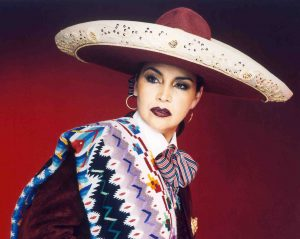 Aida Cuevas, a female mariachi singer, in traditional mariachi dress.
