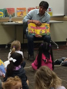 KCLS staff reading to children during Story Time