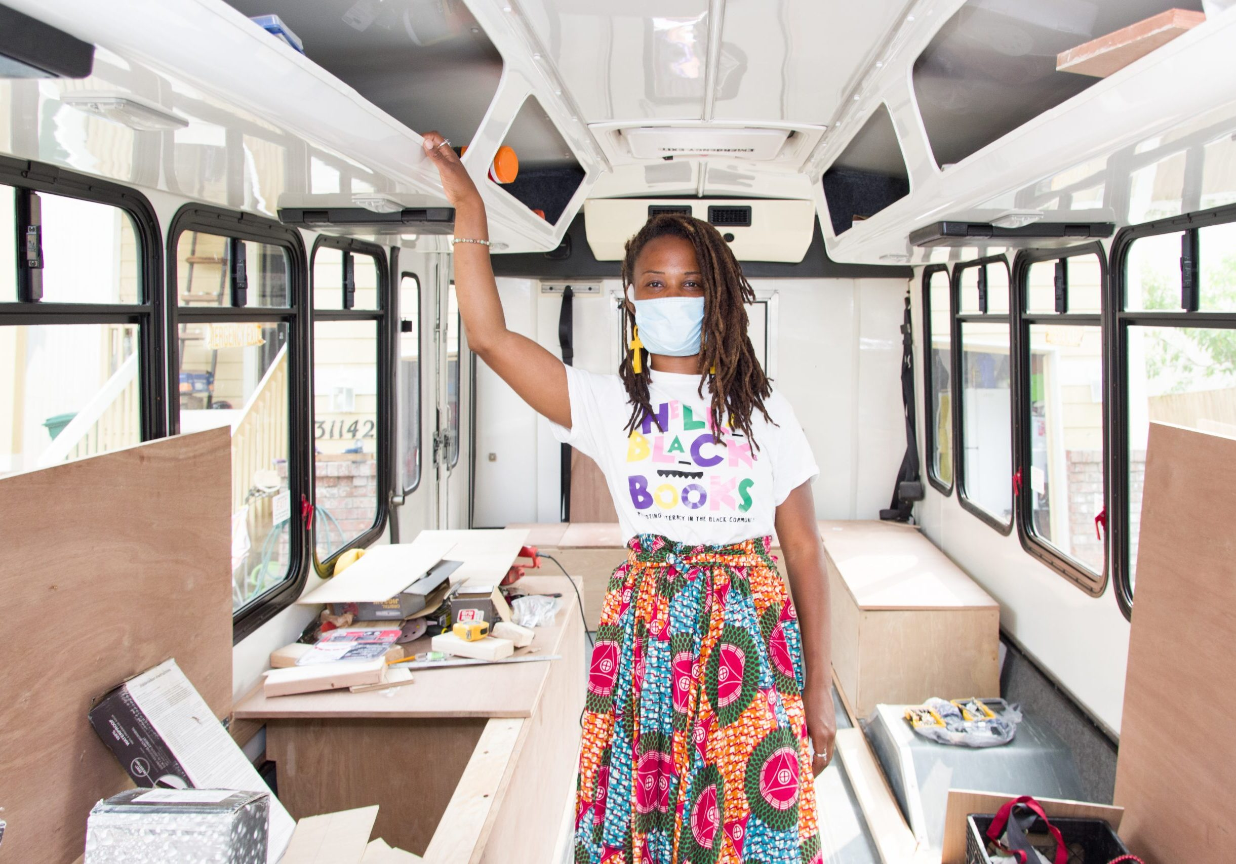 Catrice stands inside her mobile classroom